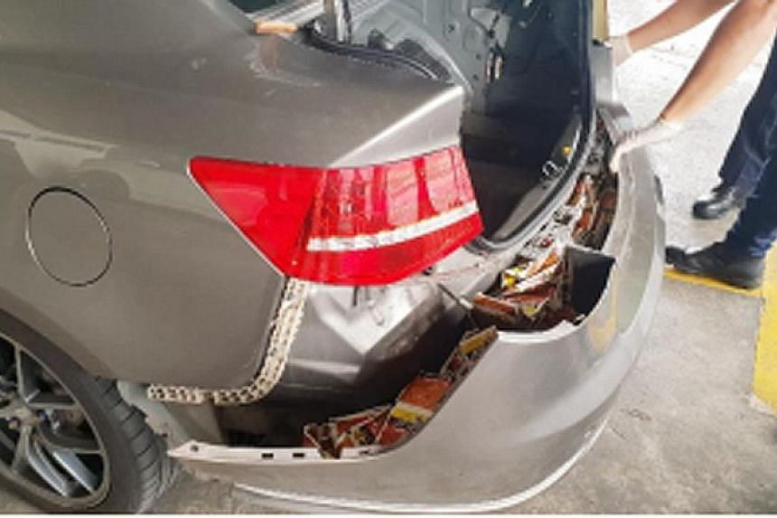 It seemed like tobacco was hidden in every part of the car - (from left) under the seats, in the rear bumper and even in the spare tyre - when Immigration and Checkpoints Authority (ICA) officers foiled a smuggling attempt at Woodlands Checkpoint on