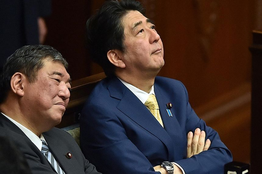 Former defence minister Shigeru Ishiba (left) and PM Shinzo Abe are both running for LDP president.