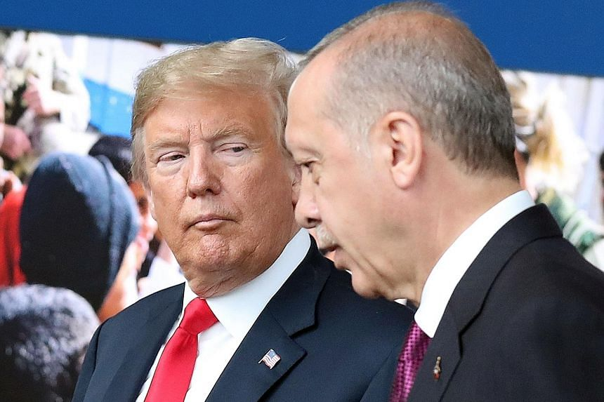 Turkish President Recep Tayyip Erdogan (right) has remained defiant in the face of pressure from US President Donald Trump.