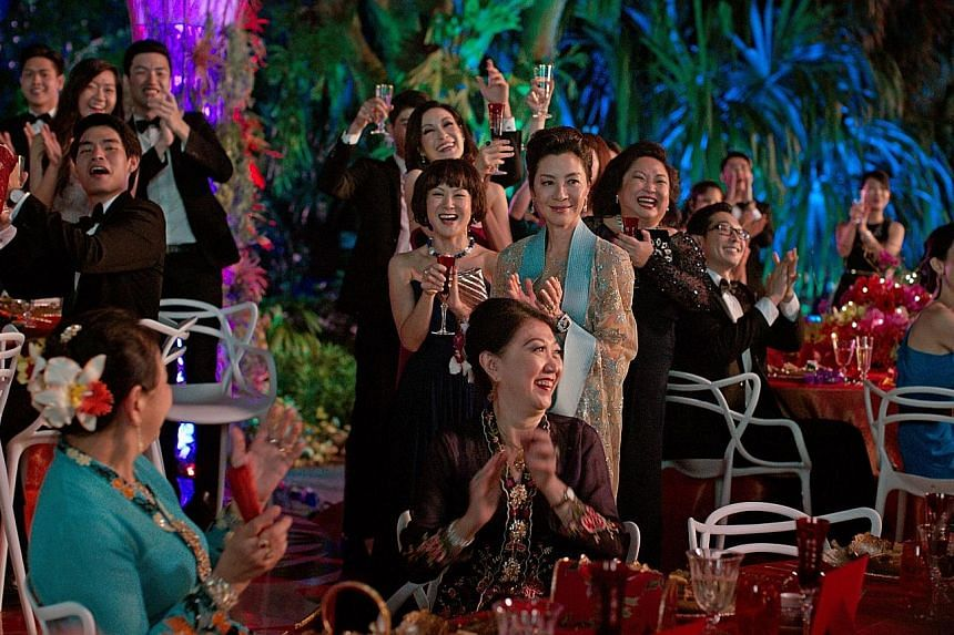 Constance Wu (left) is New Yorker Rachel Chu who accompanies her boyfriend Nick Young, played by Henry Golding, to his best friend's wedding in Singapore. Actress Michelle Yeoh (right, in beige gown) plays his disapproving mother who sets out to brea