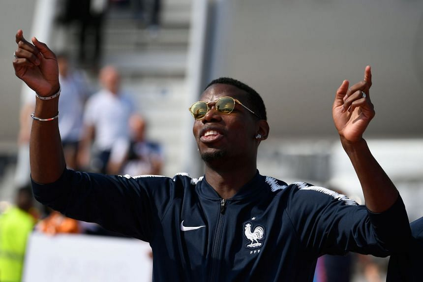 Pogba celebrates with team mates after France won the 2018 World Cup.