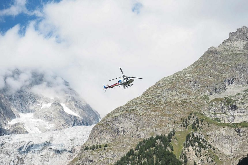 A helicopter flying over Mont Blanc, close to where the three climbers were said to be missing.