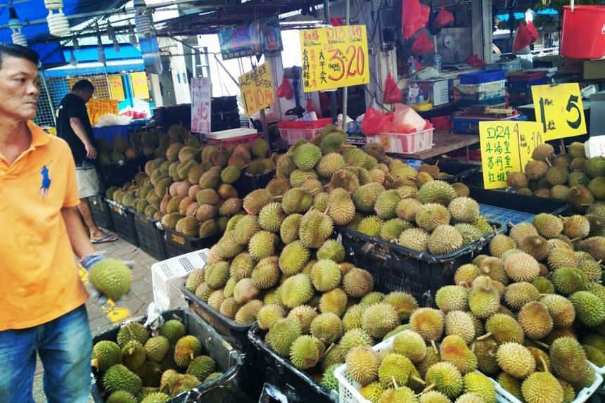 File photo showing a durian seller at a stall, on July 24, 2018.