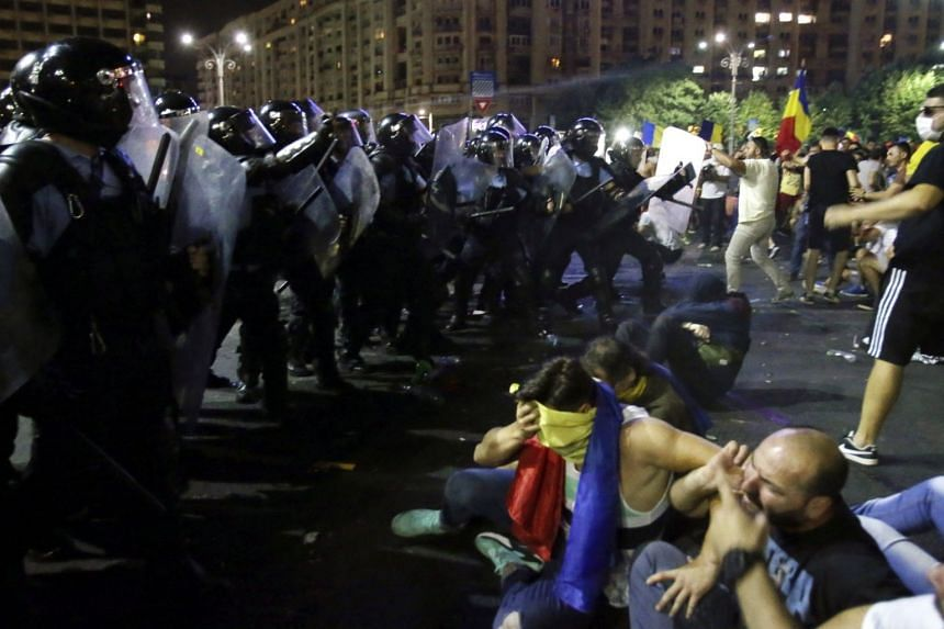 Romanian demonstrators face off against riot police during a protest against the government in Bucharest, Romania, on Aug 10, 2018.