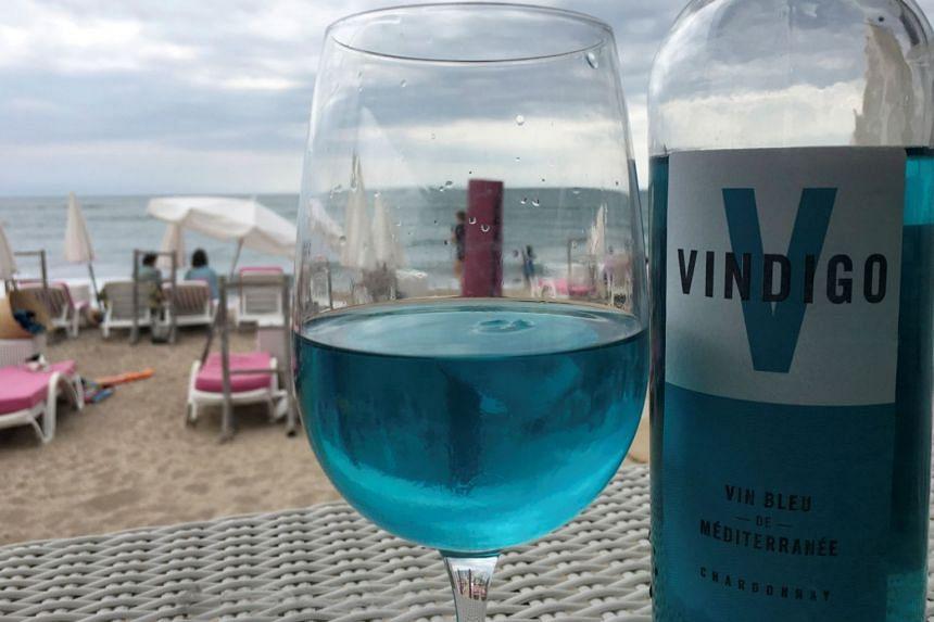 A glass of Vindigo, Mediterranean chardonnay wine, is seen at a beachfront restaurant in Sete.