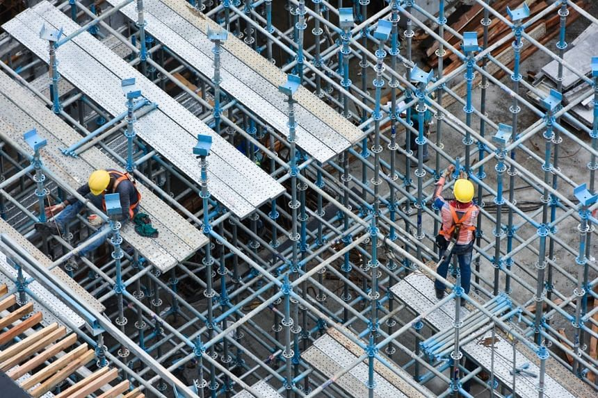File photo showing workers at a construction site in Singapore, on June 20, 2018.