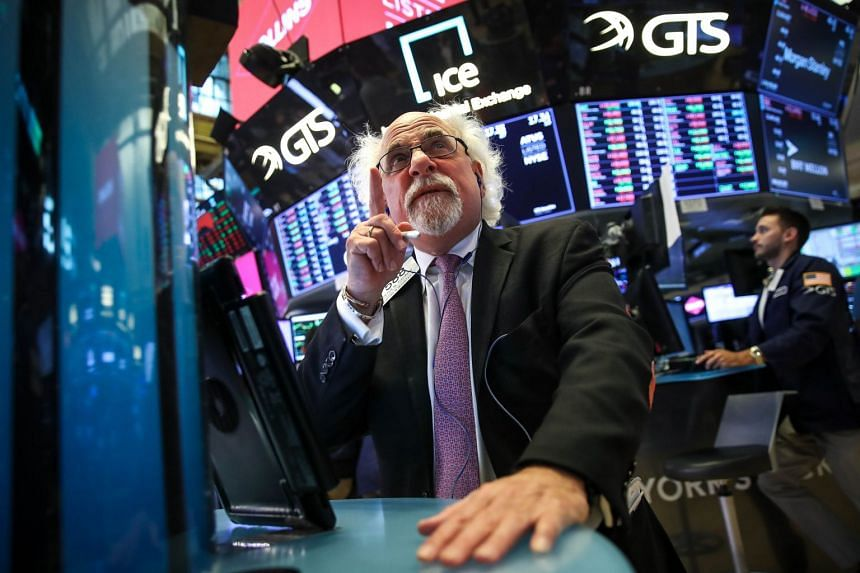 Traders and financial professionals work on the floor of the New York Stock Exchange on Aug 10, 2018.