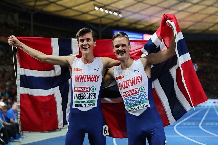 Jakob Ingebrigtsen (left) celebrates his win with second-placed Henrik Ingebrigtsen.