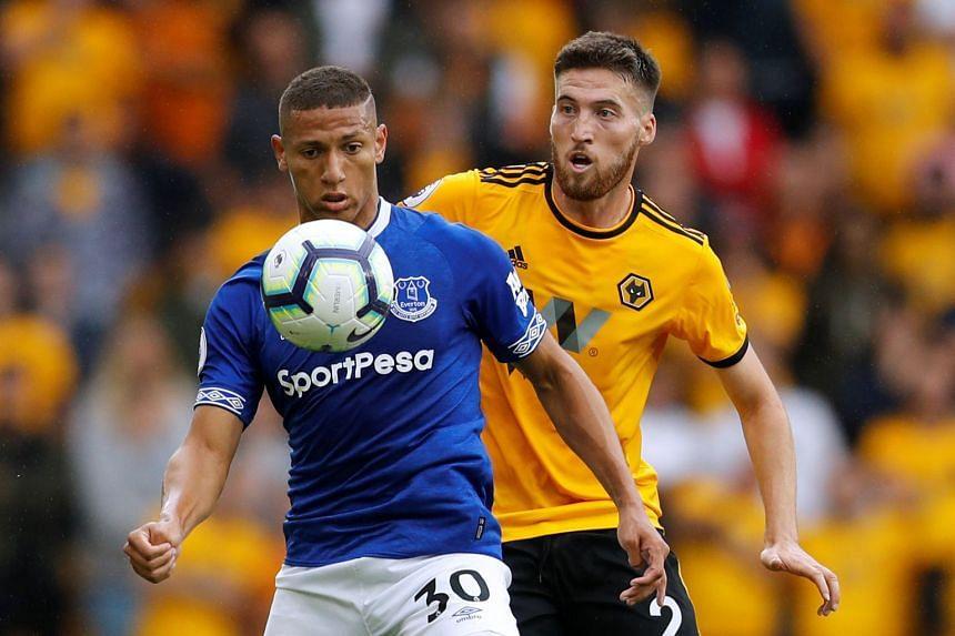 Everton's Richarlison in action with Wolverhampton Wanderers' Matt Doherty.
