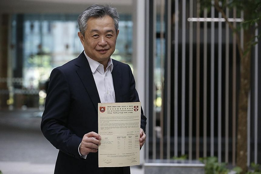 """Mr Tan Kah Chye with his GCE O-level results. The """"late developer"""" eventually became one of the top bankers in the world."""