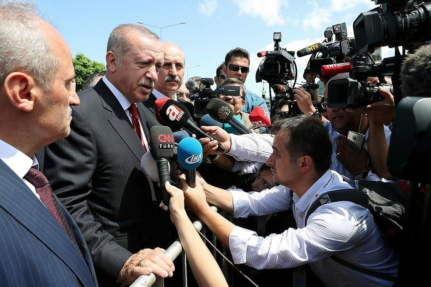 """Turkish President Tayyip Erdogan talking to the media in the Black Sea city of Ordu yesterday. Mr Erdogan has repeated a call to Turks to help support the lira in what he calls a """"war of independence"""". Turkey and the US are at odds over a wide range"""