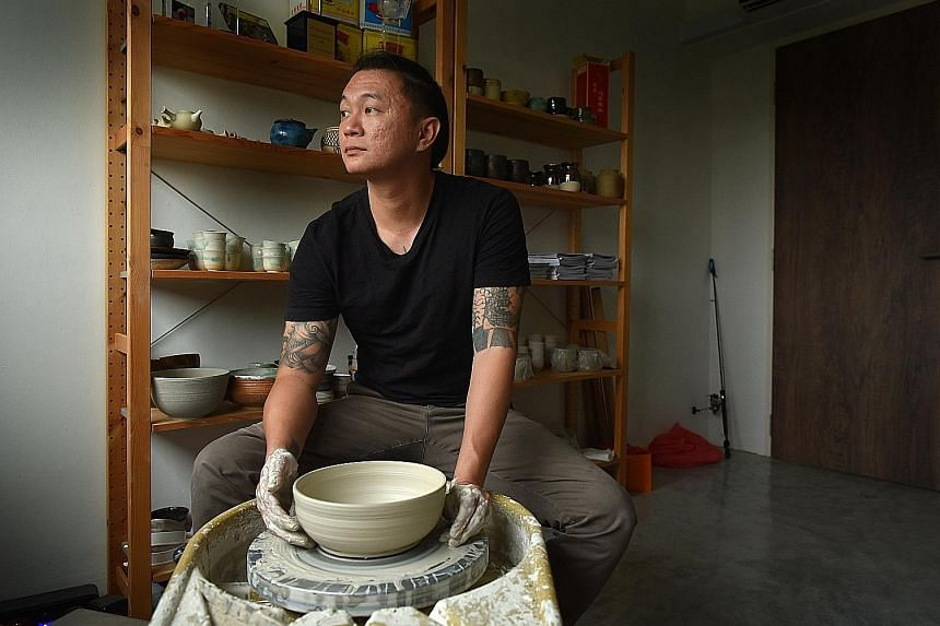 Mr Kim with his mother Foo Sai Fang in 2008. Though his parents divorced when he was 11, his mum did not fight for the flat so her kids would have a permanent roof over their heads. But that was not to be. Mr Kim Whye Kee, 39, in his pottery studio.