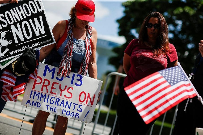 War on gangs (from left): A former gang member in a prison in El Salvador on July 16; a makeshift memorial seen on May 22 in New York, where four young men were allegedly killed by MS-13 gang members last year; Trump supporters backing the crackdown