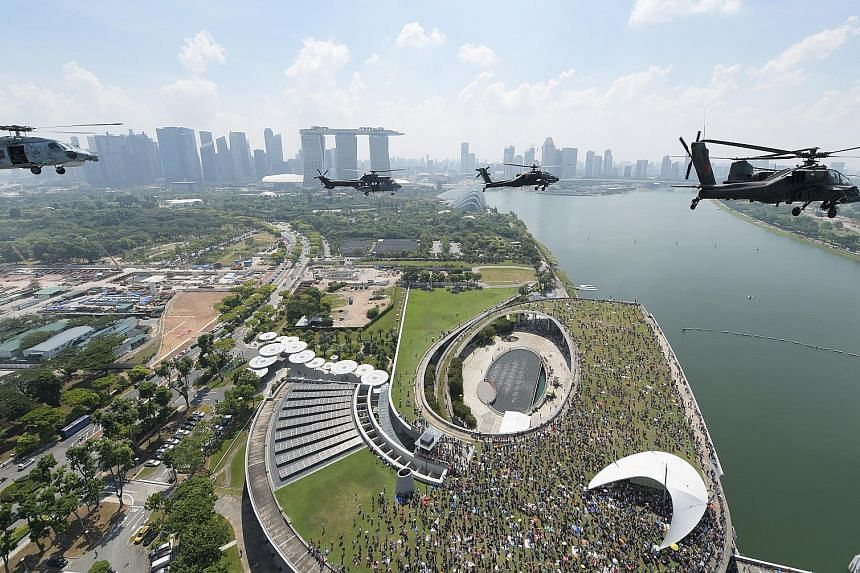 RSAF helicopters performing a fly-past witnessed by crowds at the Celebrating RSAF50 picnic at Marina Barrage yesterday. The formation consisted of a Chinook helicopter in the lead, followed by two Apaches, two Super Pumas, and a Seahawk.