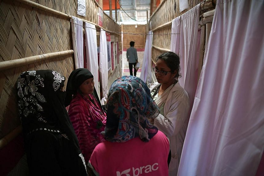 Rohingya women getting medical advice from a volunteer doctor at the NGO-run BRAC clinic, which helps pregnant women at the Kutupalong megacamp. Some 48,000 women, many of whom are victims of rape or violence, are expected to give birth in the camps