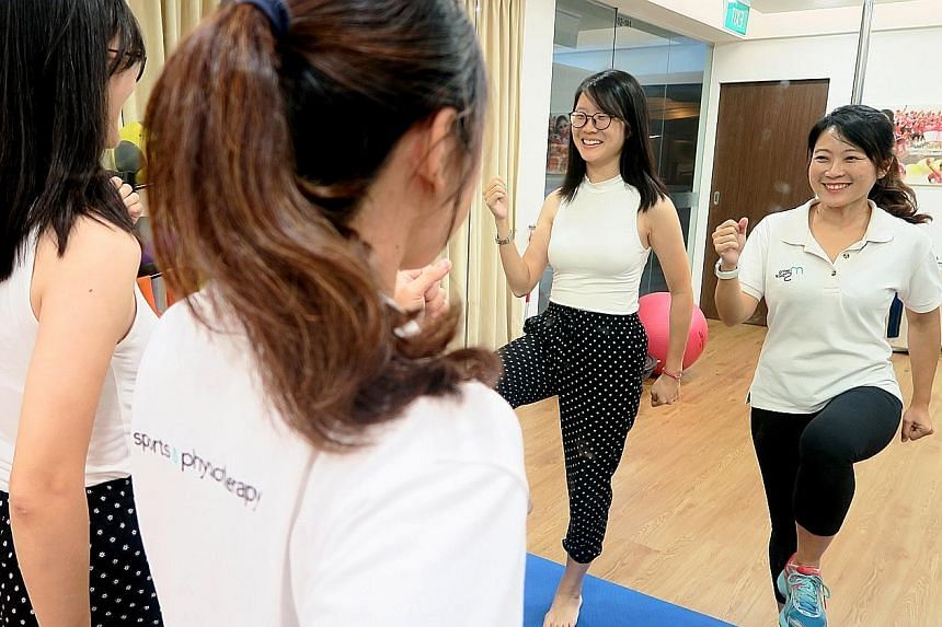 Sports physiotherapist Sharon Lim (right) demonstrating running-specific drills for better running form. One of the common mistakes is overstriding.