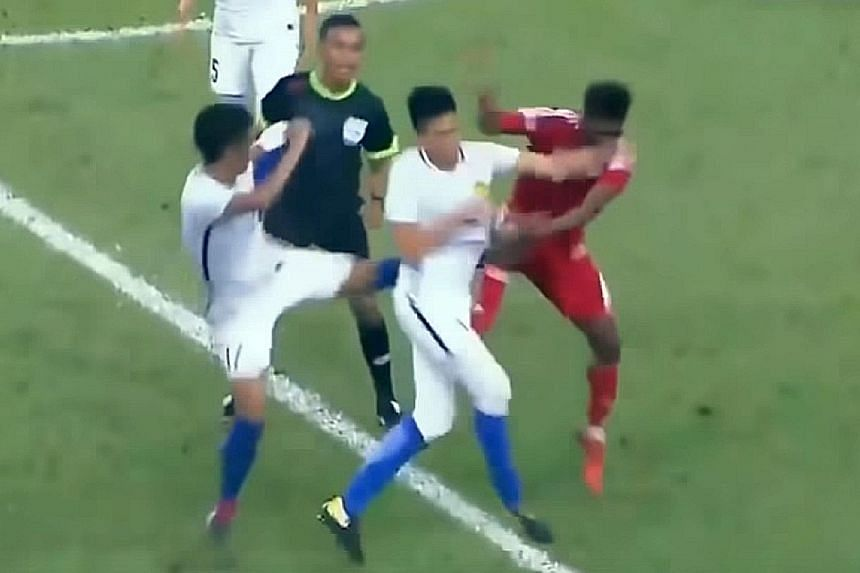The brawl on Friday was triggered off by UAE midfielder Mohammad Khalfan Eto (in red) elbowing Malaysian defender Adib Zainuddin.