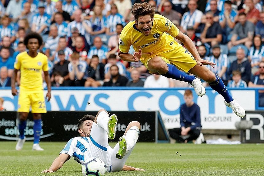Chelsea defender Marcos Alonso winning a penalty after he is fouled by Huddersfield Town's Christopher Schindler with half-time approaching. New signing Jorginho marked his league debut with a goal from the resultant spot kick.