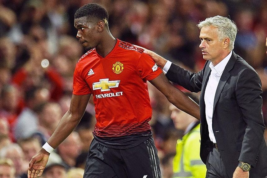Manchester United manager Jose Mourinho with Pogba as he leaves the pitch after being replaced by Marouane Fellaini in the 84th minute.