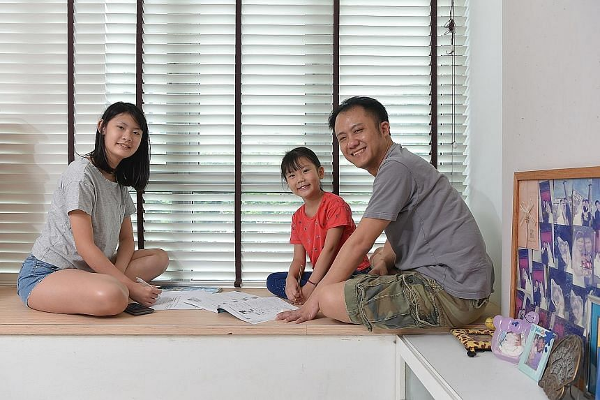 Mr Samuel Lim chose to stay home and homeschool his daughters Phoebe (left) and Priscilla because he wanted them to learn more things than just academic subjects.
