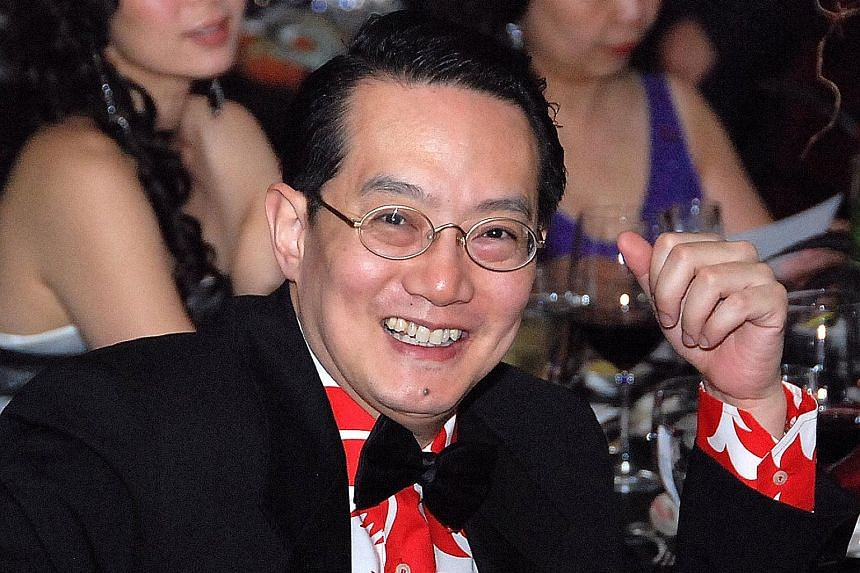 Dr Woffles Wu, in a photo taken in 2008, had to roll up his sleeves to wash dishes and wait tables at his restaurant.