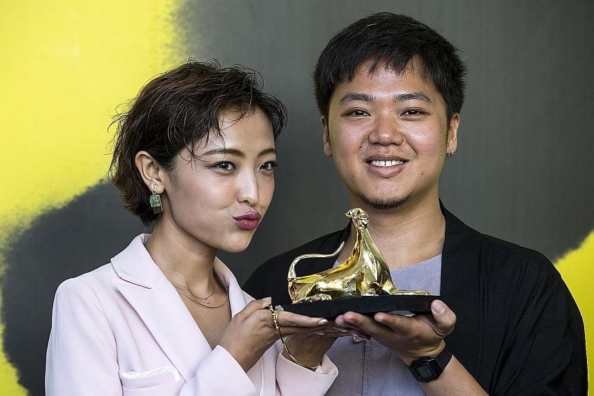 Chinese actress Luna Kwok and Mr Yeo Siew Hua with the Pardo d'Oro (Golden Leopard) which he won yesterday for his film A Land Imagined.