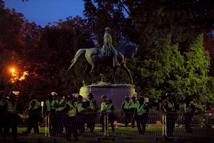 Police in riot gear were deployed around the statue of Civil War Confederate General Robert E. Lee in Charlottesville, on Aug 11, 2018.
