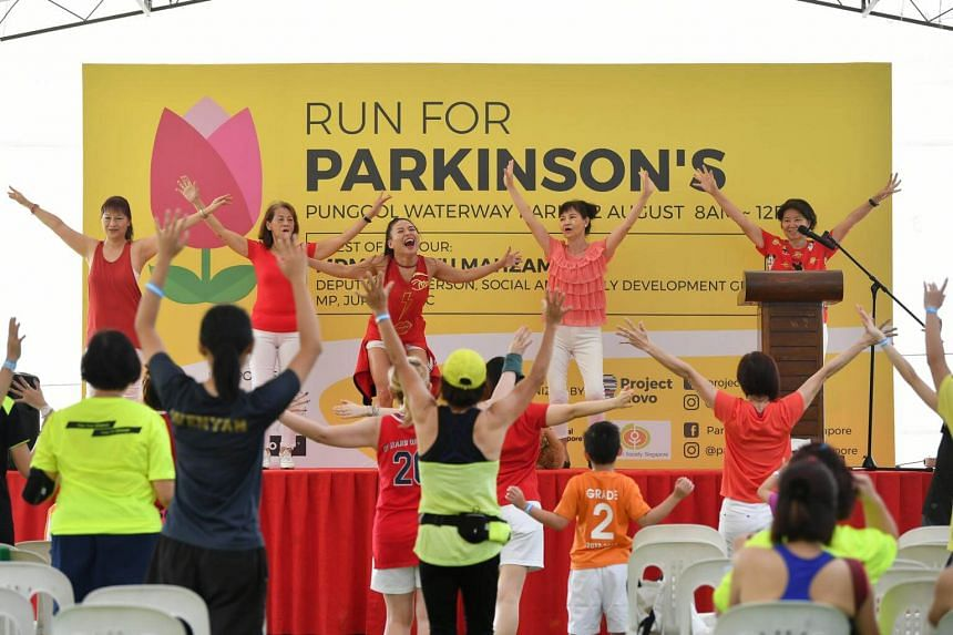 Participants doing zumba at Run for Parkinson's 2018 at Punggol Waterway Park, on Aug 12, 2018.