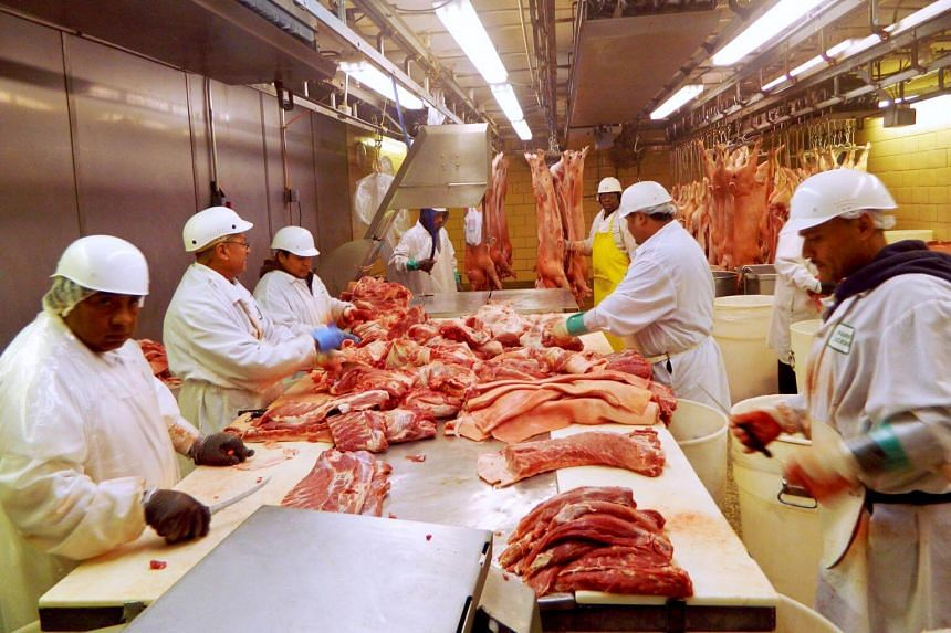 Workers cut pork at Park Packing in Chicago, Illinois, on July 18, 2015.