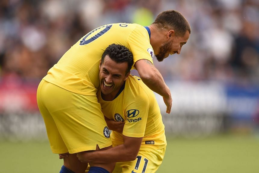 Chelsea's Pedro (right) celebrates with Eden Hazard after scoring the team's third goal.
