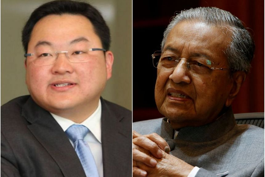 A spokesman for fugitive businessman Jho Low (left) said Malaysian PM Mahathir Mohamad has once again showed that the proper legal process has no place in his regime.