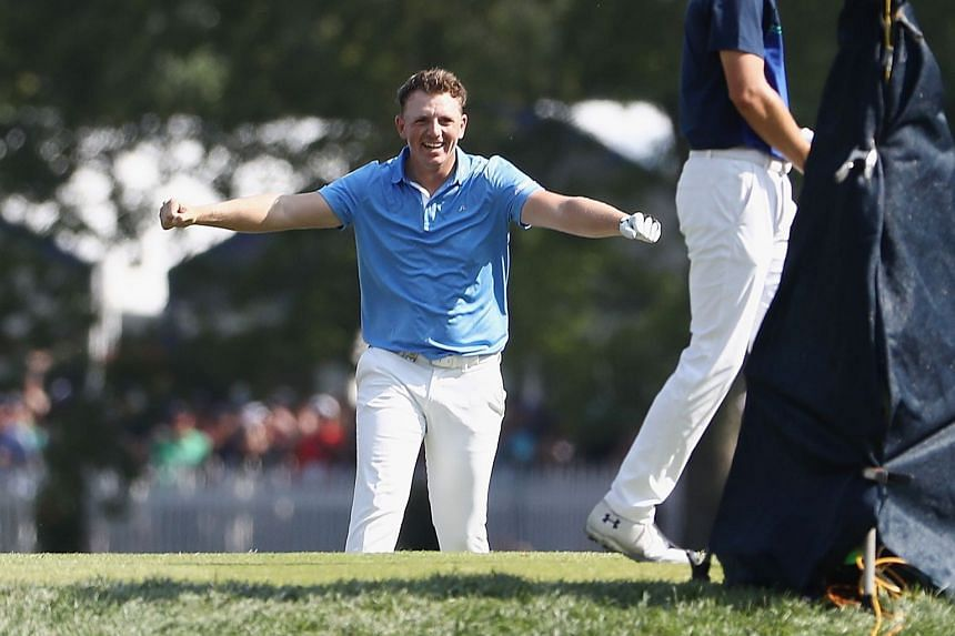 Matt Wallace of England celebrates after making a hole-in-one.
