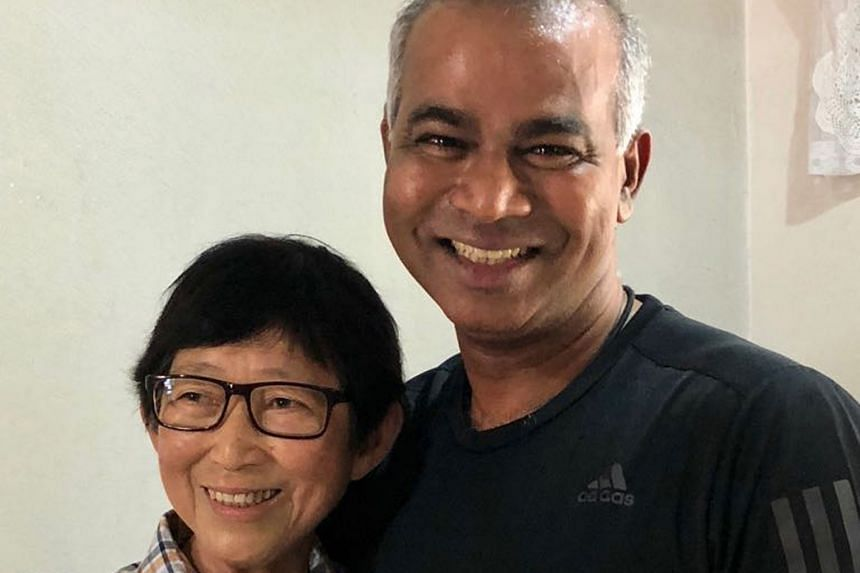 Mr Veera Sekaran with his former teacher, Mrs Chee Siew Chuan. Her kind act of putting together a stationery set and a school bag for him when he was in Canberra Primary was featured in a film at the National Day Parade. Her daughter reached out to h