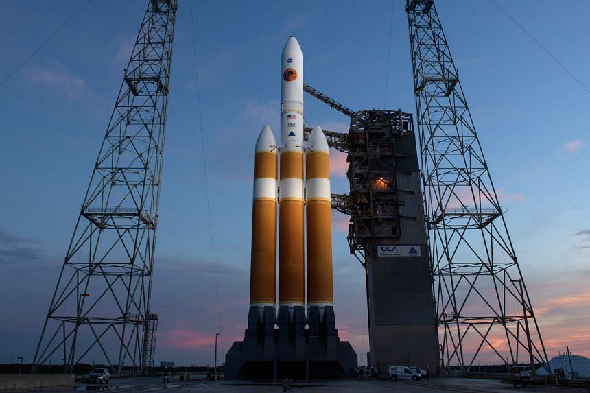 A Nasa photo showing the car-sized Parker Solar Probe on board a Delta IV Heavy rocket on Friday. It has been rescheduled for launch today to give engineers time to investigate the problem.