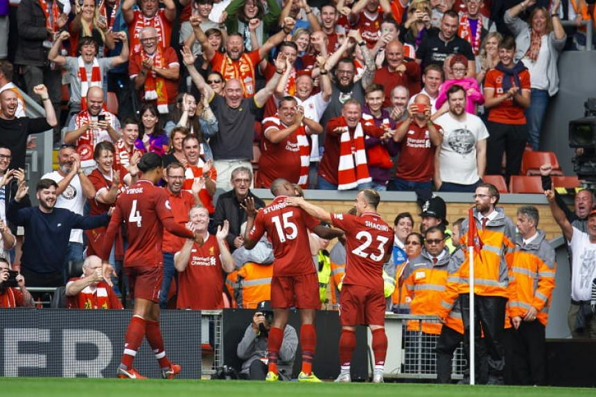 Liverpool's Daniel Sturridge (centre) celebrates scoring their fourth goal during the English Premier League soccer match against West Ham at the Anfield in Liverpool on Aug 12, 2018.