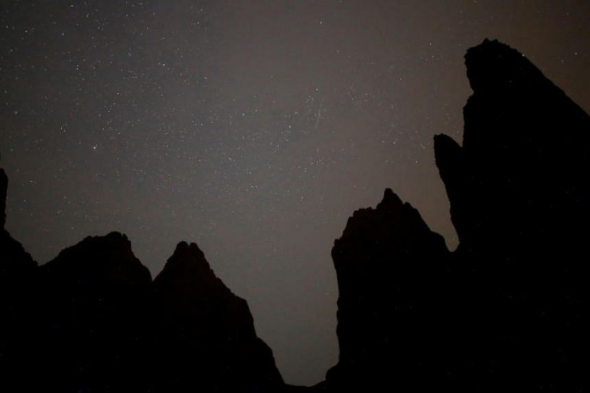 A meteor streaks across the skies over the Sand Pyramids during the peak of the Perseid meteor shower in the village of Miljevina in Bosnia and Herzegovina on Aug 12, 2018.