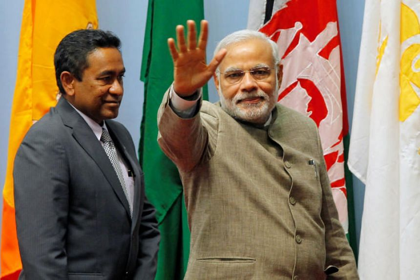 A file photo taken on Nov 27, 2014, shows India's Prime Minister Narendra Modi waving as Maldives President Abdulla Yameen looks on during the closing session of 18th South Asian Association for Regional Cooperation summit in Kathmandu.
