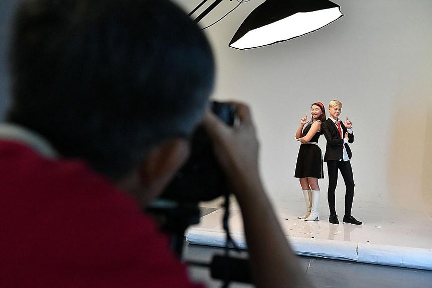 Singers Natasha Hui Min Bjerg, 14, and Bastien Buwalda, 13, striking a pose for the cameras as they prepare for a photo shoot for this year's ChildAid concert. The annual charity concert in November will be taking a trip down memory lane and showing