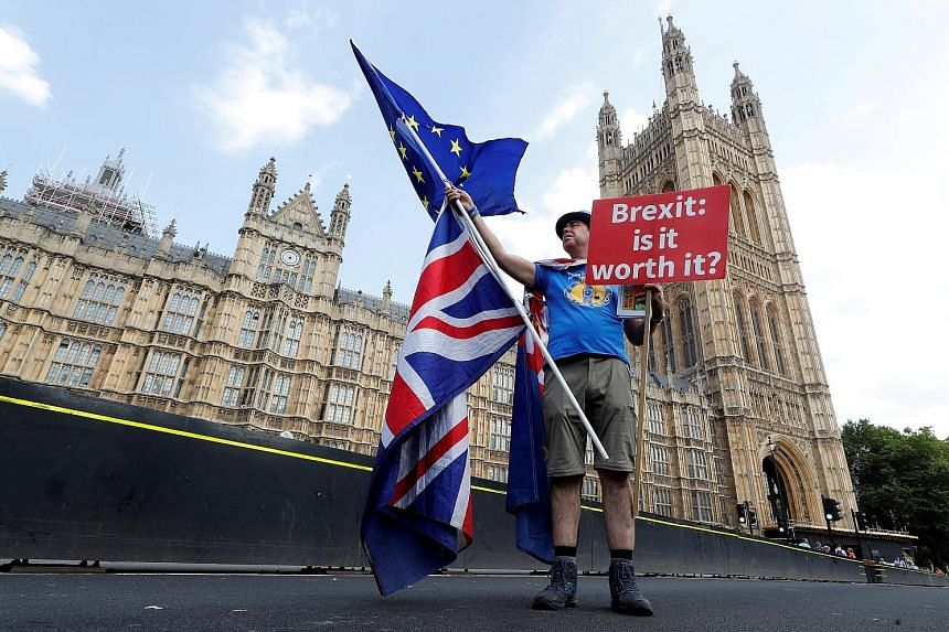 Saying it loud and clear with an anti-Brexit banner on Westminster Bridge, in central London. The sterling's slump to a nine-month low in recent days on growing concern over the prospect of a cliff-edge Brexit is pushing up costs for Britons going ab