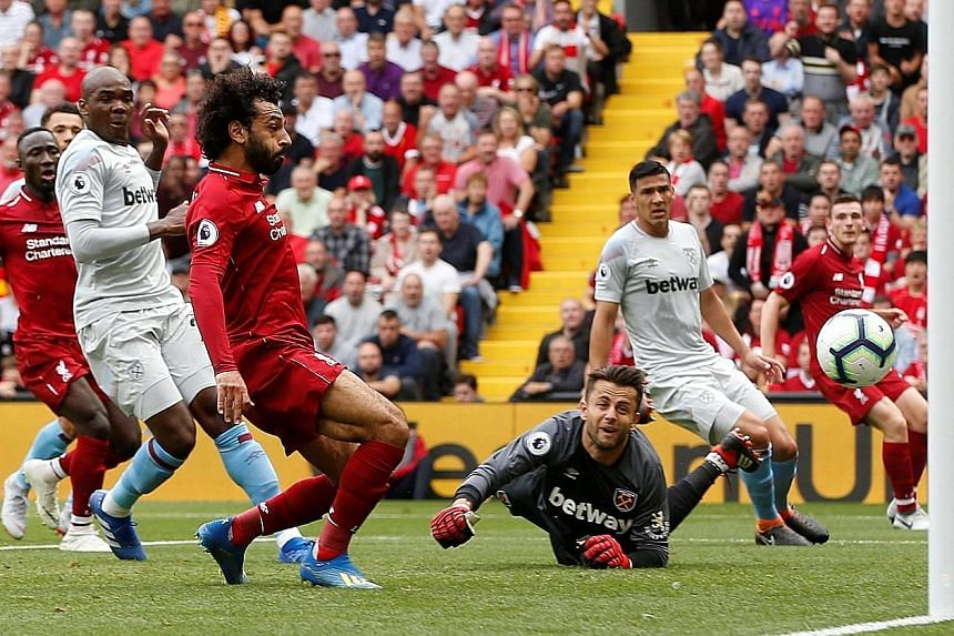 Mohamed Salah opens his and Liverpool's account for the season as he taps the ball past West Ham goalkeeper Lukasz Fabianski. Sadio Mane added a brace and Daniel Sturridge put the icing on the cake with a fourth.