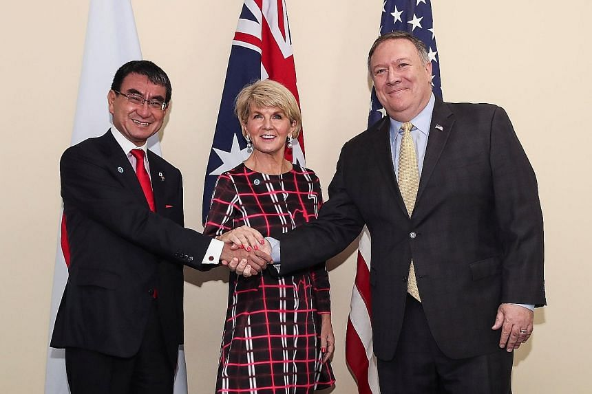 (From left) Japanese Foreign Minister Taro Kono, Australian Foreign Minister Julie Bishop and US State Secretary Mike Pompeo posing on Aug 4 before a trilateral meeting on the sidelines of the 51st Asean Foreign Ministers Meeting in Singapore.