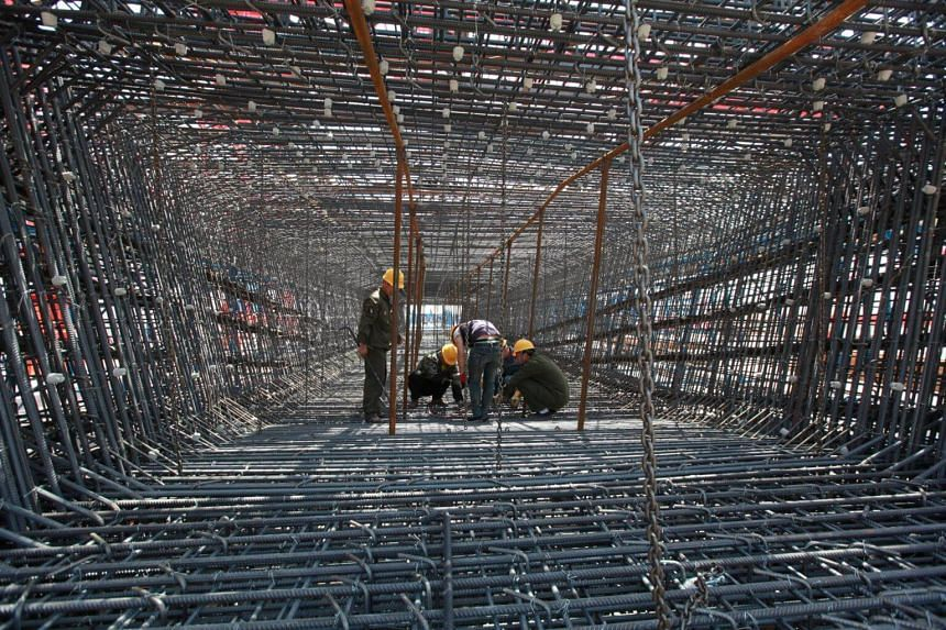 Labourers work on the construction site of a high-speed railway in Linyi, China.