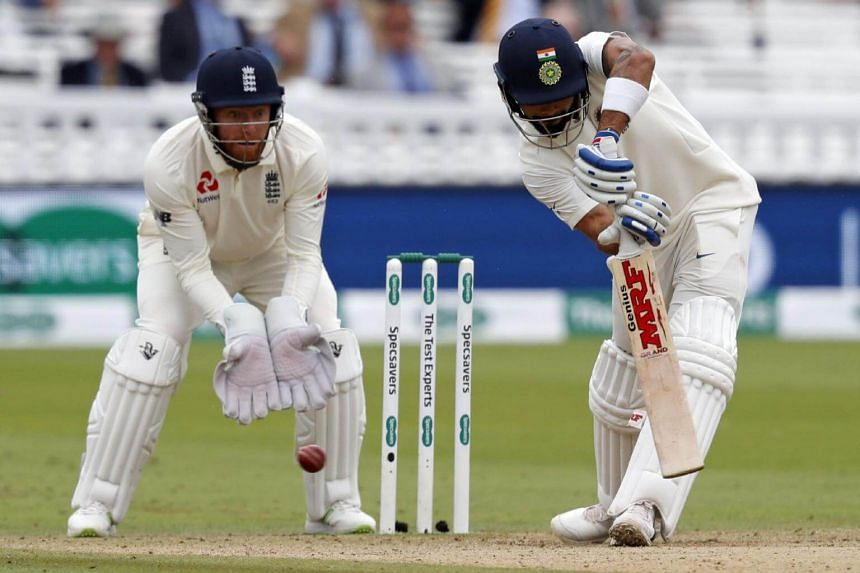 India's captain Virat Kohli plays a shot as England's Jonny Bairstow keeps wicket during play on the fourth day of the second Test cricket match between England and India at Lord's Cricket Ground in London, on Aug 12, 2018.