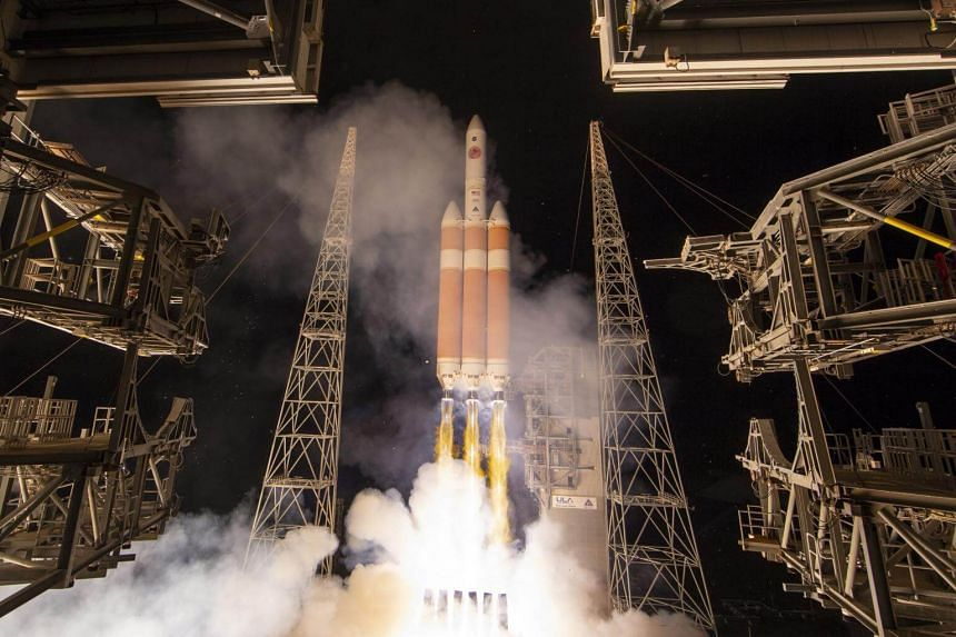 The United Launch Alliance Delta IV Heavy rocket launches Nasa's Parker Solar Probe to touch the Sun, from Launch Complex 37 at Cape Canaveral Air Force Station, on Aug 12, 2018.