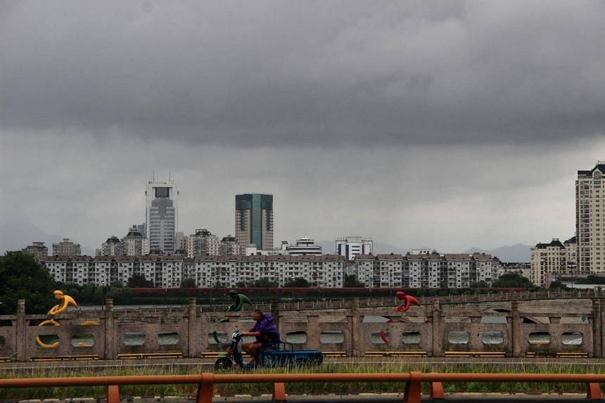 Dark clouds gather above the city of Shaoxing before Typhoon Yagi is expected to make landfall in Zhejiang province, China, on Aug 12, 2018.