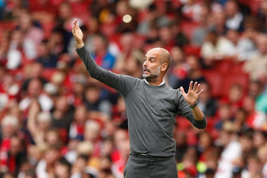 Manchester City manager Pep Guardiola in the Emirates Stadium, London, Britain, on Aug 12, 2018.