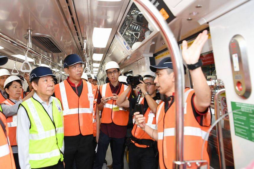 Transport Minister Khaw Boon Wan (left) and New SMRT CEO Neo Kian Hong (second from left) at the pre-launch of the new C151C trains on Aug 13, 2018.