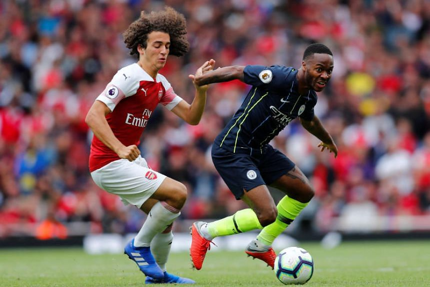 Manchester City's Raheem Sterling (right) tussles with Arsenal midfielder Matteo Guendouzi.