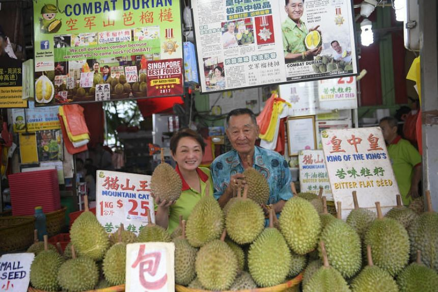 Ang Seck Puan, 80, the boss of Combat Durian, the oldest durian stall in Singapore, and his daughter Linda Ang on 1 Aug, 2018.
