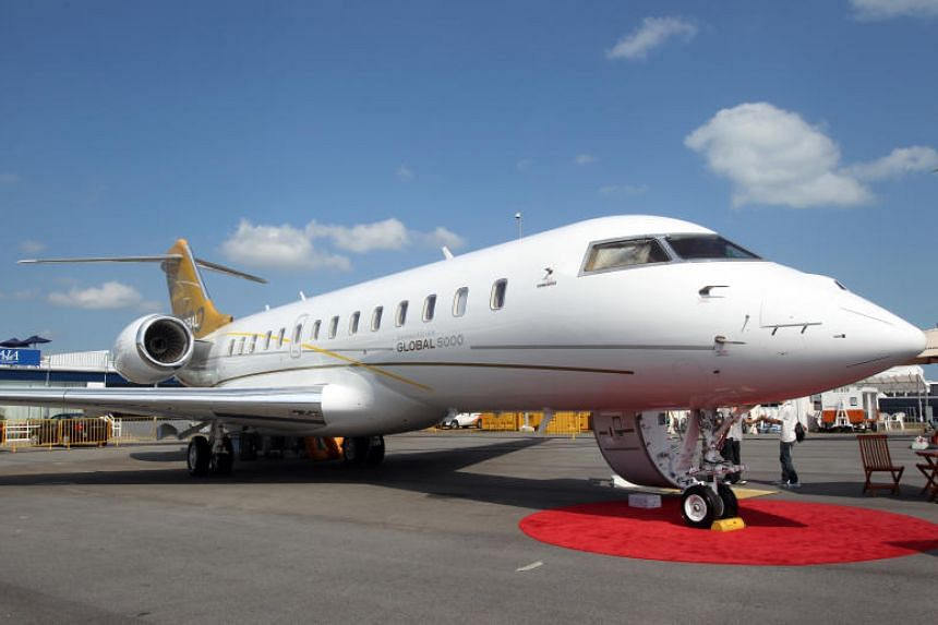 """A Bombardier Global 5000 aircraft at Singapore Airshow 2010. Malaysian Prime Minister Mahathir Mohamad said that businessman Low Taek Jho's Bombardier Global 5000 jet would be returned to Malaysia """"as soon as possible""""."""